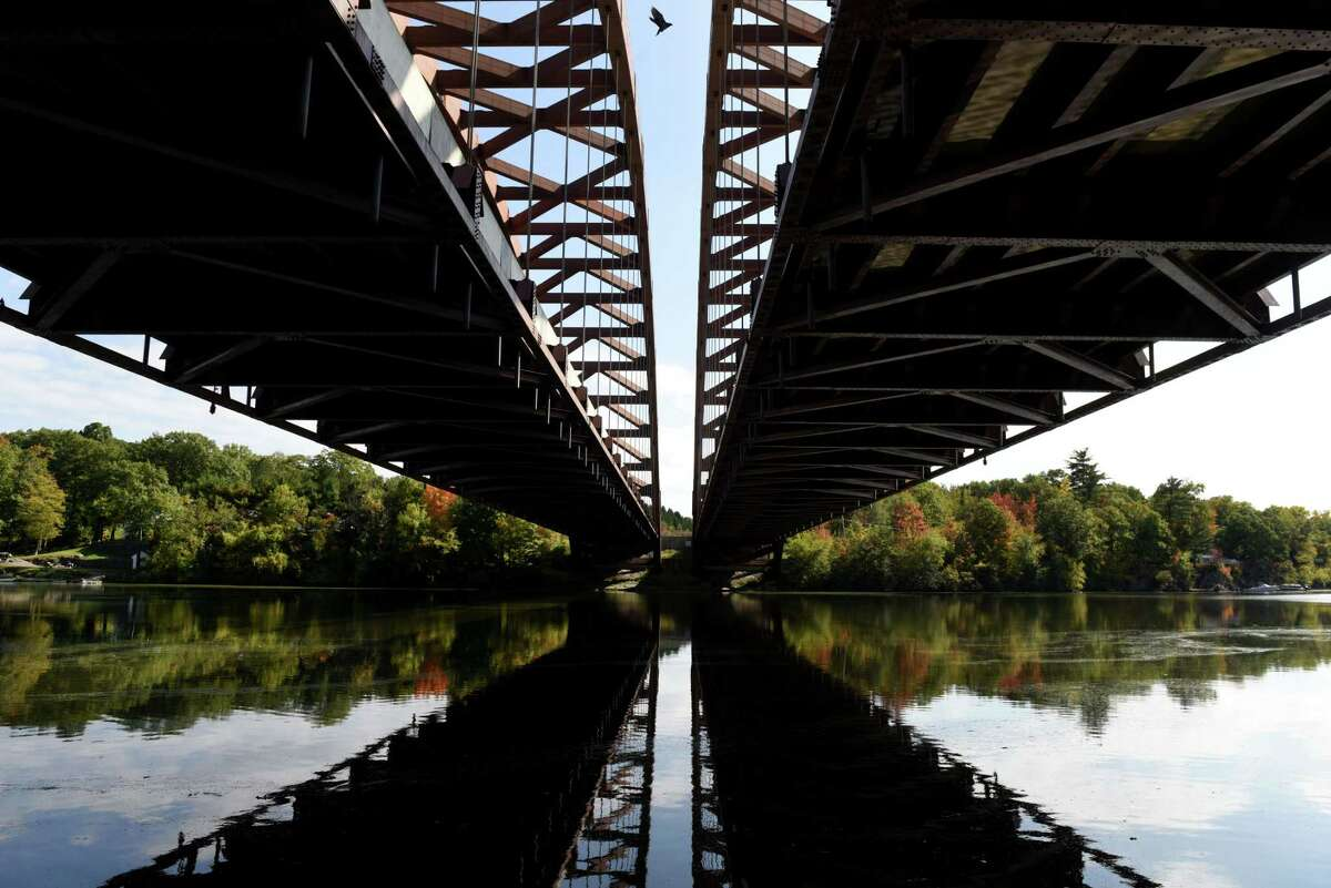 Fall colors are reflected on the Mohawk River under Thaddeus Kosciuszko Bridge on Monday, Oct. 5, 2020, in Halfmoon, N.Y. (Will Waldron/Times Union)