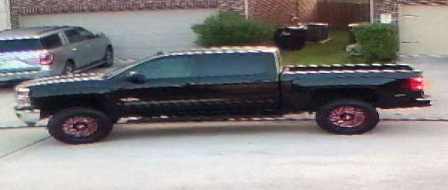 Pictured is the lifted black Chevrolet Silverado said to be driven by an unidentified man who allegedly fired multiple bullets at a house Oct. 3 in Spring. Photo: Courtesy Of The Montgomery County Sheriff's Office