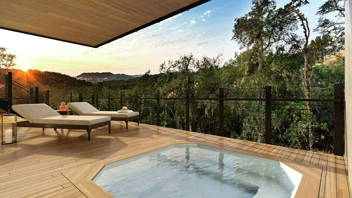 This covered terrace off the lower level of one of the 25 Harvest homes at Montage Residences Healdsburg features a hot tub.