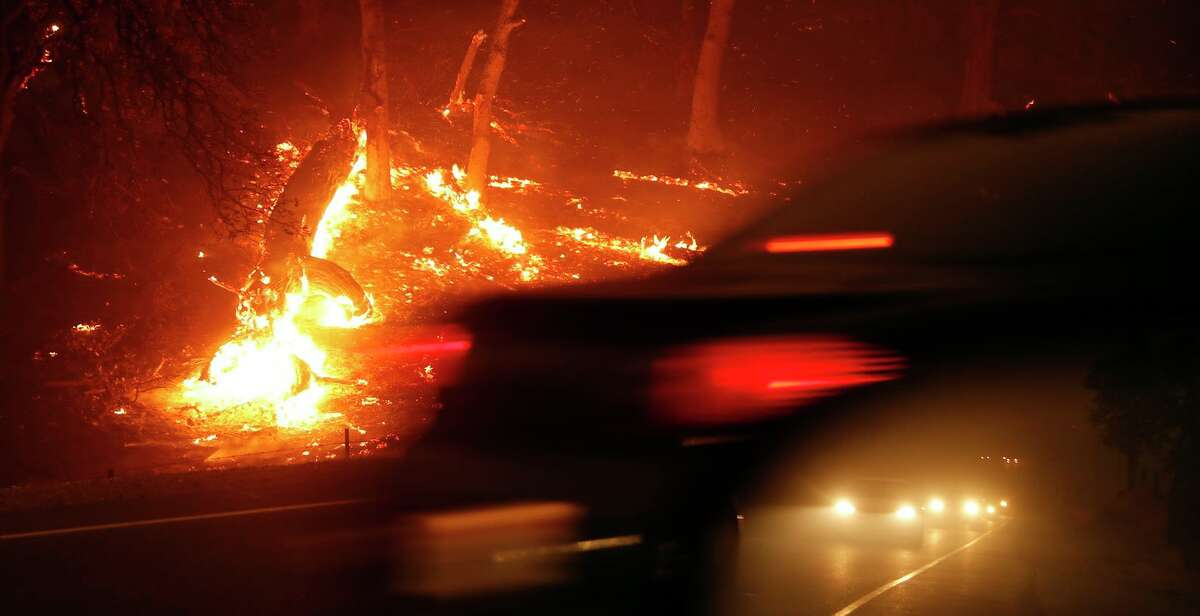 Motorists evacuate on Hwy. 191 during the Camp Fire in Paradise (Butte County) in November 2018.