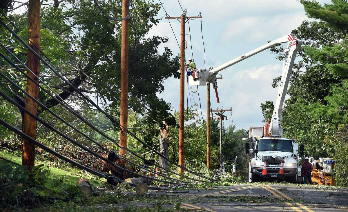 """United Illuminating crews repair electric lines on new poles on Shepard Avenue in Hamden on August 28, 2020. A """"mishap"""" at a construction site caused a loss of power for almost 100 Ansonia residents Wednesday evening."""
