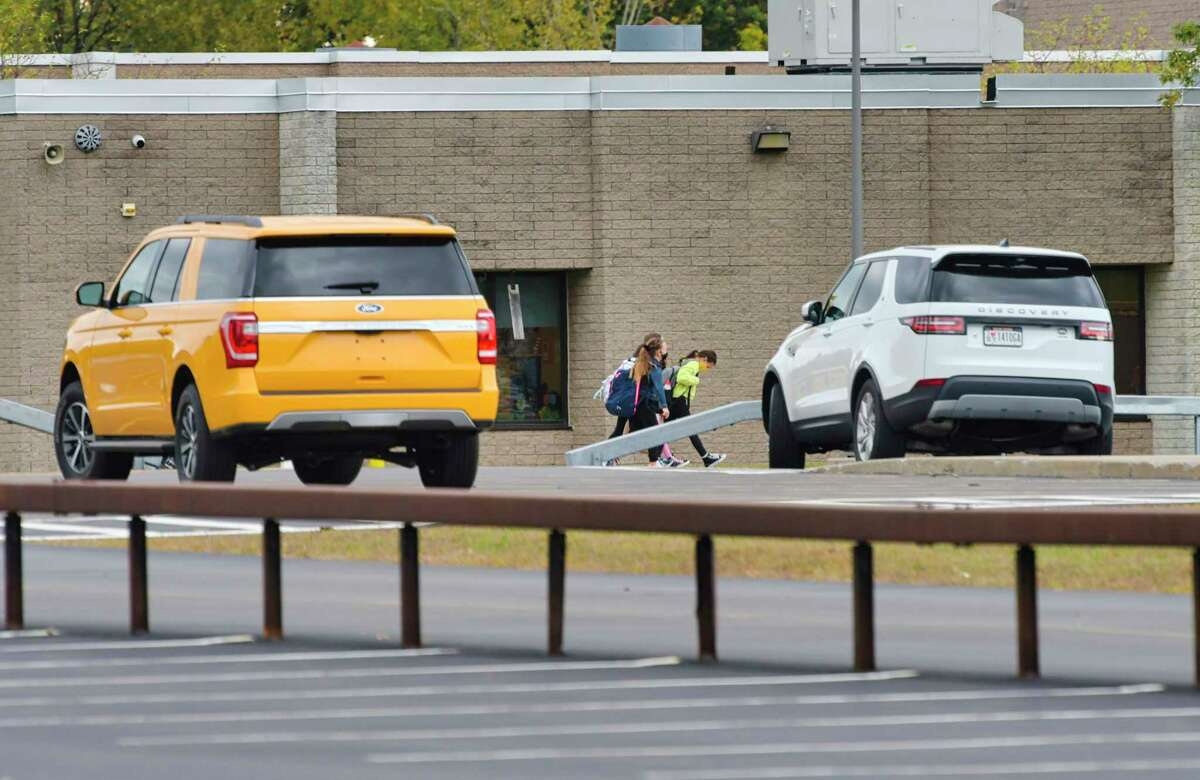 Students walk into Wood Road Elementary School on Monday, Oct. 5, 2020, in Ballston Spa, N.Y. The Ballston Spa school is in lockout mode on Thursday after a suspect escaped from the Saratoga County Sheriff deputies. (Paul Buckowski/Times Union)