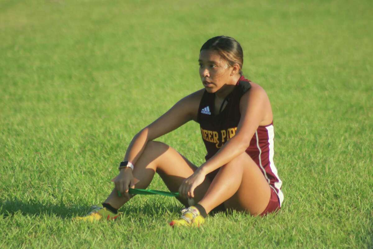 Deer Park's Anissa Garza rests just outside the finish chute after capturing first place Friday morning. Three of the top-10 times were turned in by the Lady Deer.