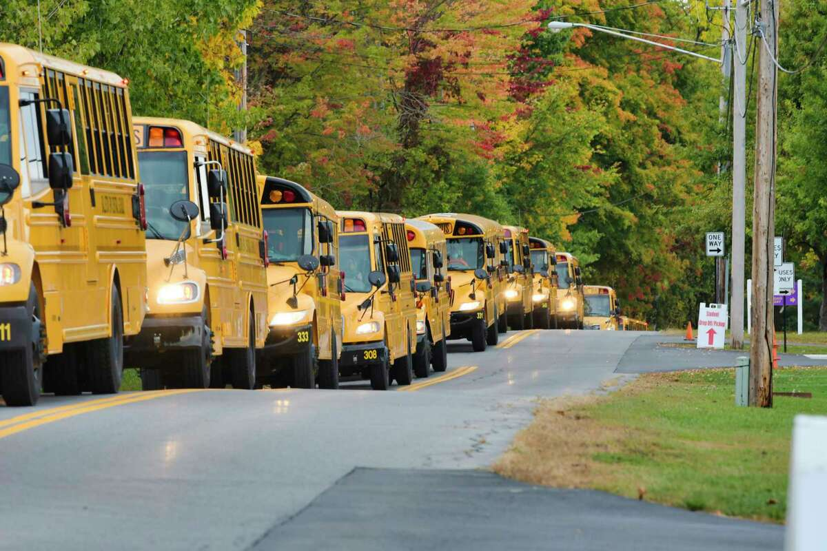 Buses leave Gordon Creek Elementary School after dropping students off on Monday, Oct. 5, 2020, in Ballston Spa, N.Y. Ballston Spa school district went back to in-person learning Monday. (Paul Buckowski/Times Union)