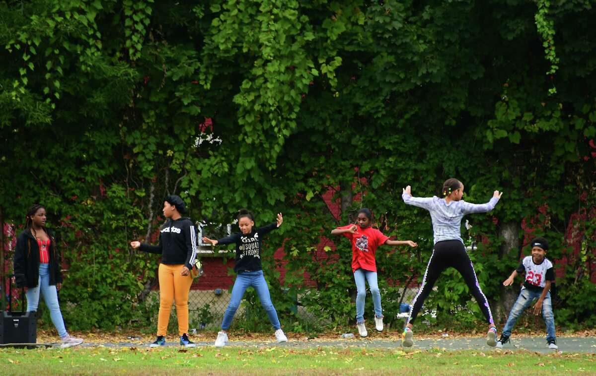 Kids dance to music on a basketball court in the Black Lives Matter Park on Monday, Oct. 5, 2020 in Albany, N.Y. (Lori Van Buren/Times Union)