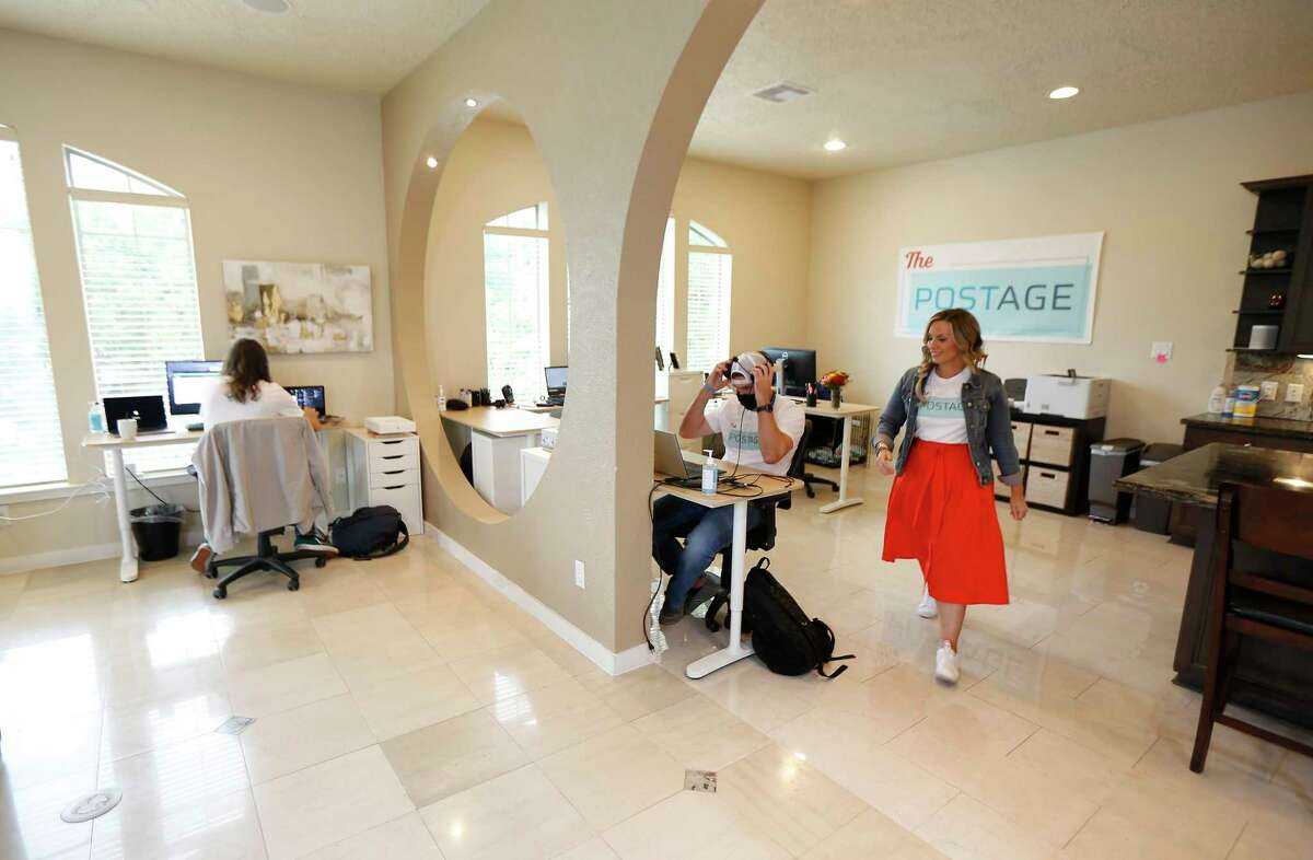 Emily Cisek, co-founder and CEO of The Postage, walks in her Houston startup that helps manage the affairs of those approaching the end of their lives via a website Monday, Sept. 28, 2020, in Houston.