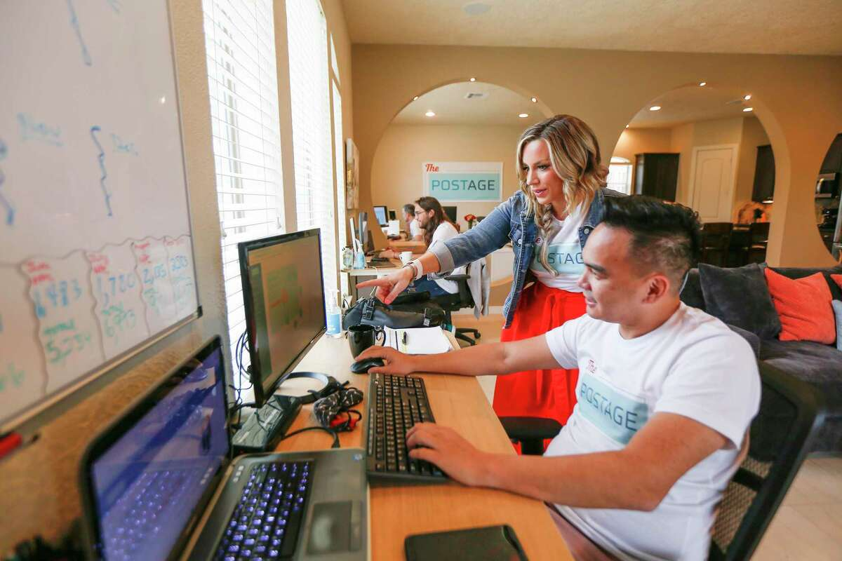 Emily Cisek, co-founder and CEO of The Postage (left), works with product insight analyst William Fermo Monday, Sept. 28, 2020, in Houston.