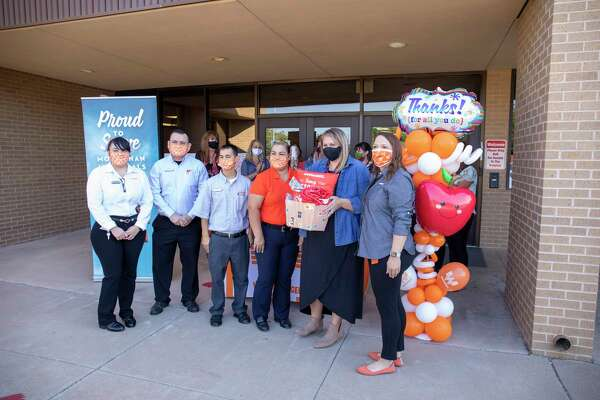 Whataburger gave eight teachers gift cards and Whataburger swag in observance of World Teachers?• Day on Monday, Oct. 5, 2020 at Parker Elementary School. Katie Cates, second from right, received the Fancy ketchup gift bucket. Jacy Lewis/Reporter-Telegram