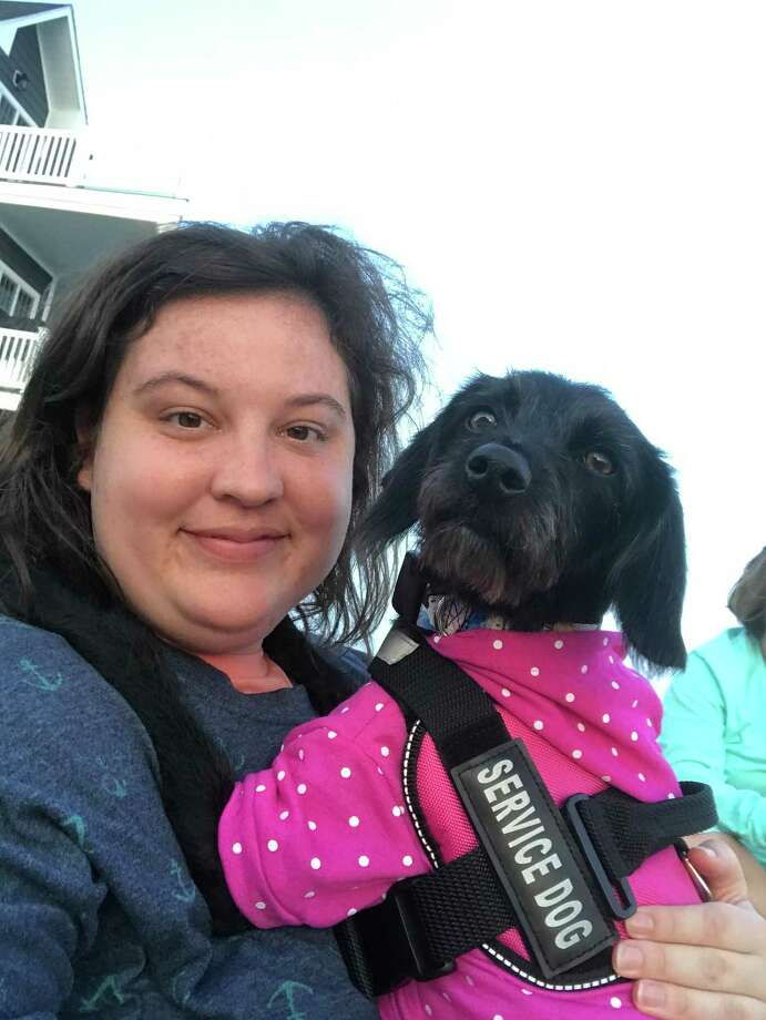 Kara-Anne and her service dog, Stella Photo: Contributed Photo / Connecticut Post