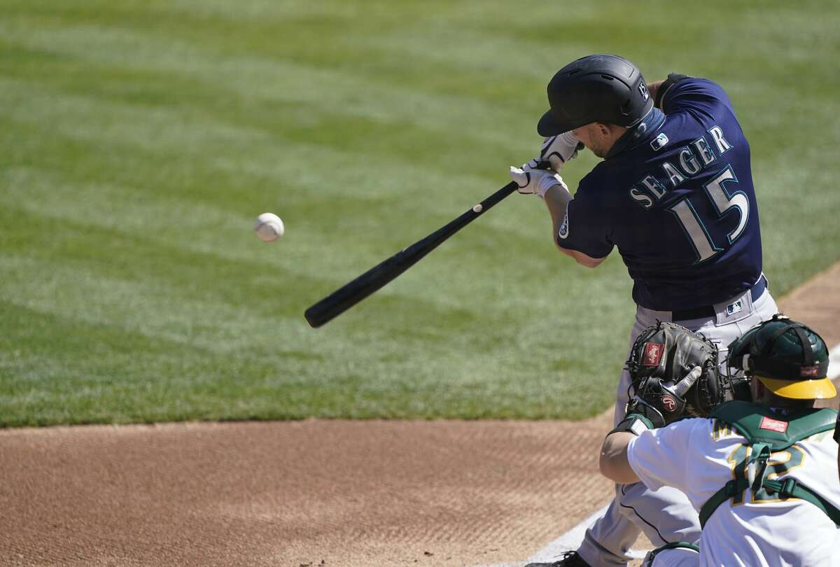 OAKLAND, CALIFORNIA - SEPTEMBER 27: Kyle Seager #15 of the Seattle Mariners bats against the Oakland Athletics in the top of the first inning at RingCentral Coliseum on September 27, 2020 in Oakland, California. (Photo by Thearon W. Henderson/Getty Images)