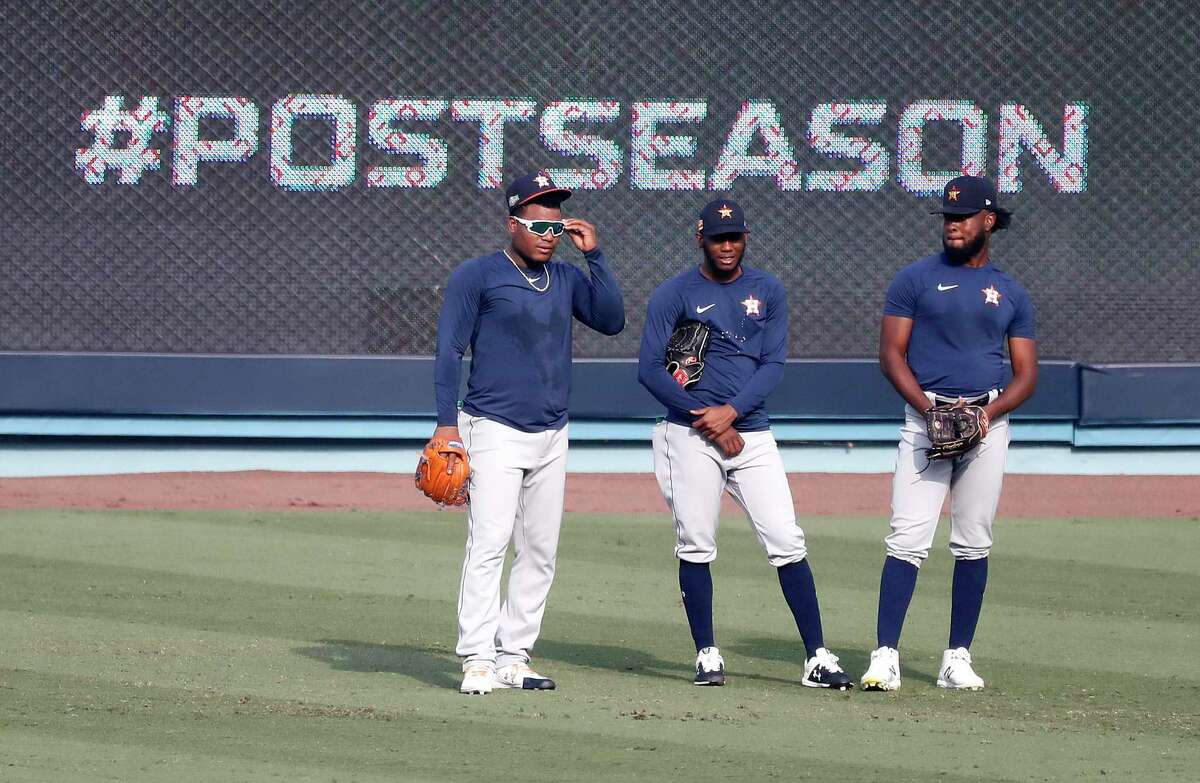 Houston Astros pitchers Framber Valdez, Enoli Paredes, and Cristian Javier watch during batting practice and workouts, Sunday, October 4, 2020, in Los Angeles, as the Astros prepared to take on the Oakland Athletics in Game 1 of the ALDS, Monday, at Dodger Stadium.