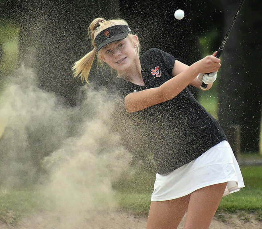 Edwardsville's Caitlyn Dicks hits a shot out of the bunker earlier in the regular season. EHS will hit the road Tuesday for Marion to play a practice round at Kokopelli Golf Club, which features 96 bunkers on the 18-hole course, before the regional on Wednesday.