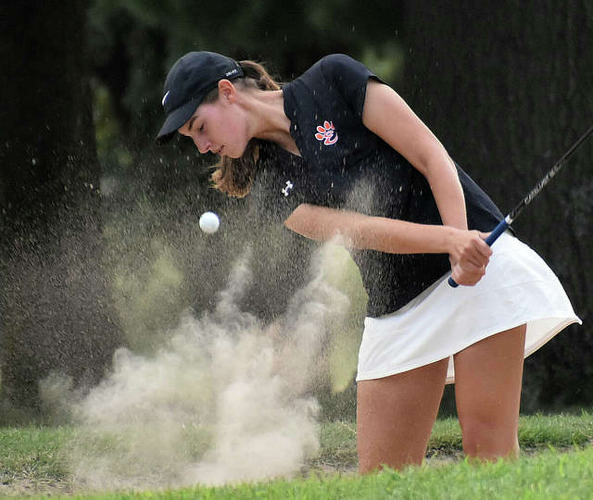 Edwardsville's Nicole Johnson hits a shot out of the bunker earlier in the regular season. EHS will hit the road Tuesday for Marion to play a practice round at Kokopelli Golf Club, which features 96 bunkers on the 18-hole course, before the regional on Wednesday.