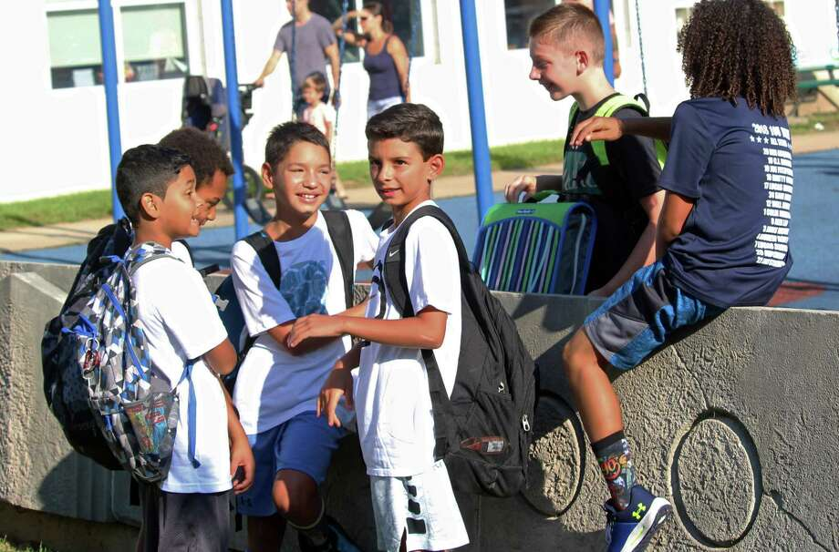 Children hanging out at the McKinley Elementary School playground in 2018. Photo: Genevieve Reilly / Hearst Connecticut Media / Fairfield Citizen