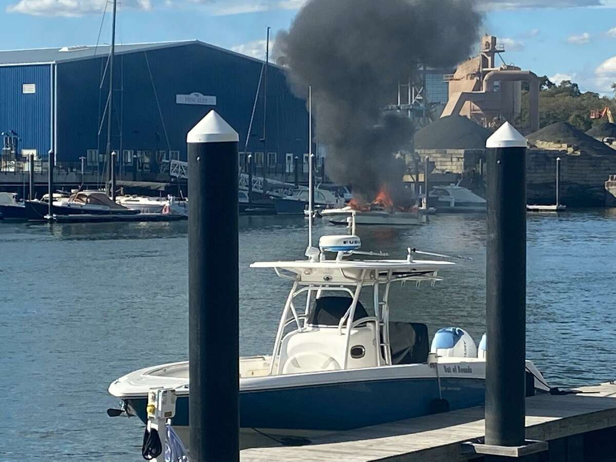 This picture shows the burning 1978 Sea Ray beginning its drift across the Stamford Harbor on Saturday afternoon.
