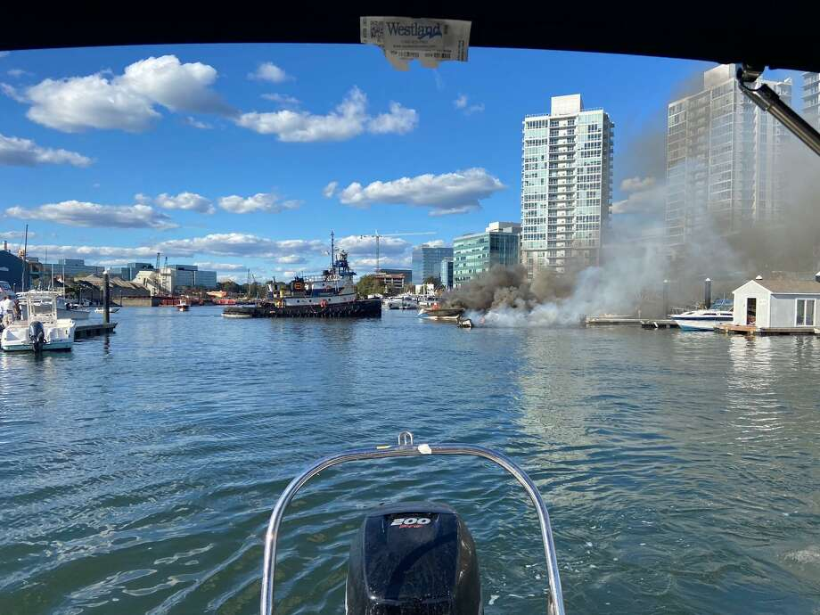 This picture shows the boats burning on the east side of Stamford Harbor after the burning Sea Ray caught the others on fire. Photo: Mitch Heffernan / Contributed