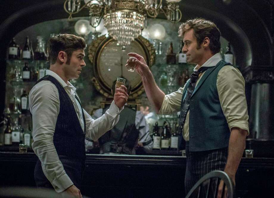 Trackside Teen Center will show the film, The Greatest Showman, starring Zac Efron, left, and Hugh Jackman, outdoors on Oct. 9. Photo: Niko Tavernise / Associated Press / TM & © 2017 Twentieth Century Fox Film Corporation. All Rights Reserved. Not for sale or duplication.