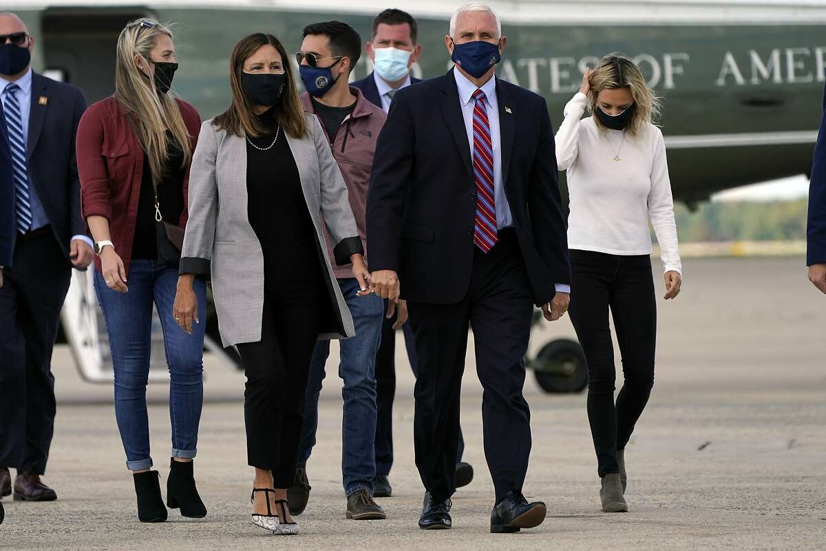 Vice President Mike Pence and his wife, Karen, along with Sarah Pence (left), husband Michael Pence and daughter Charlotte Pence Bond, arrive at Andrews Air Force Base in Maryland.