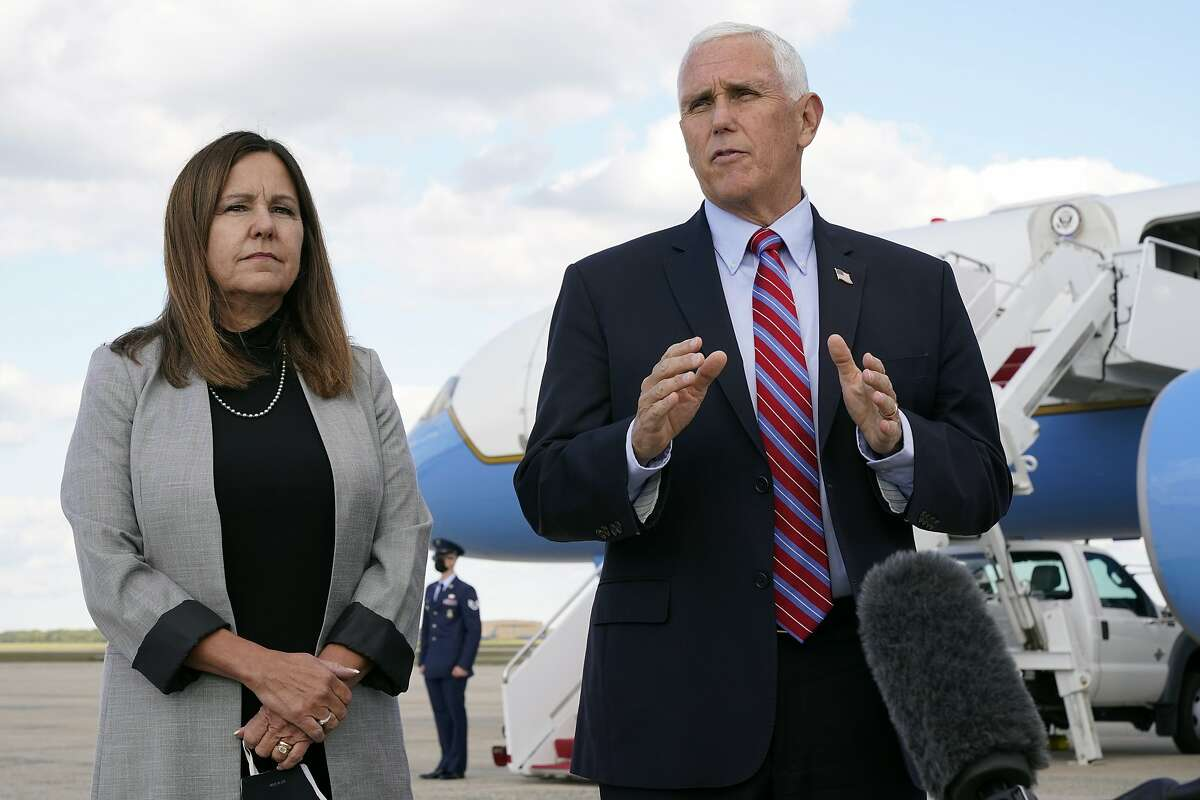 Vice President Mike Pence prepares to leave for Utah at Andrews Air Force Base, Md., with wife Karen Pence.