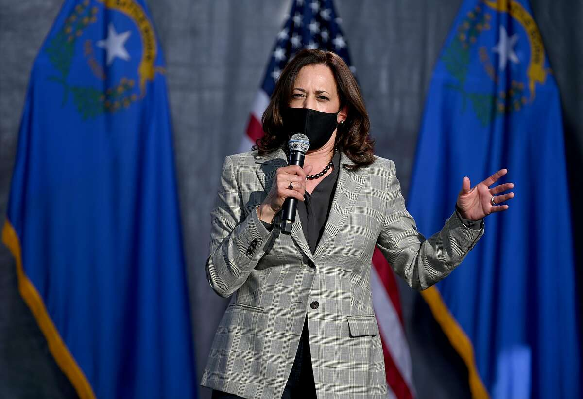 Democratic nominee Sen. Kamala Harris of California speaks during a voter mobilization drive-in event Friday in Las Vegas.