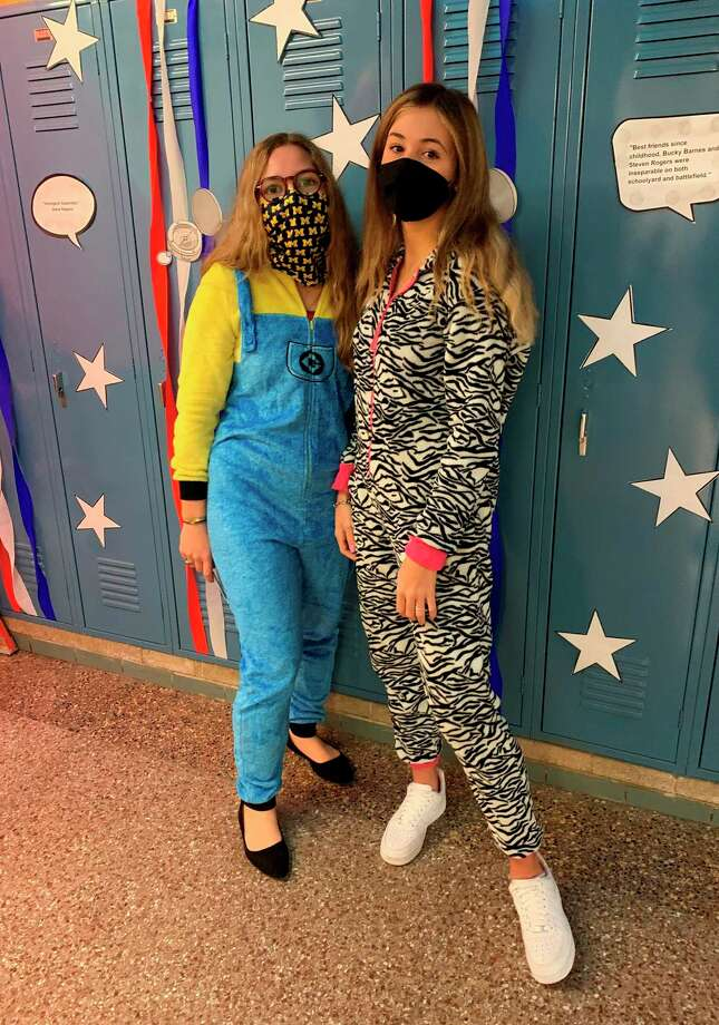 Seniors Cameron Sutcliffe (left) and Beatrice Calista take a break from decorating the halls for homecoming week during Manistee Catholic Central Schools' Pajama Day on Monday. (Courtesy photo)