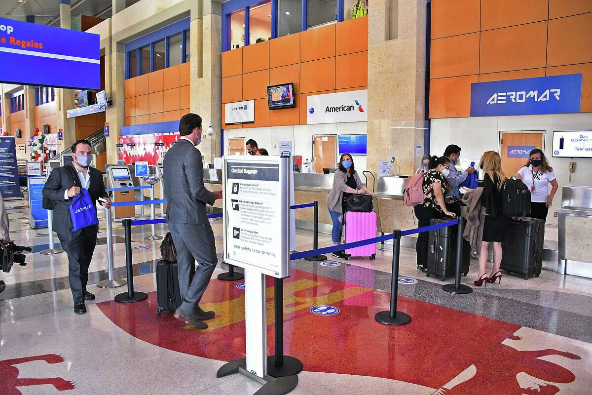 Passengers line up for their tickets for the inaugural flight for AeroMar at the Laredo International Airport, Monday, October 5, 2020. The airport will hold a COVID-19 vaccination event on Monday.