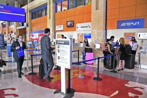 Passengers line up for tickets for the inaugural flight for AeroMar at Laredo International Airport on Oct. 5. An initiative approved Monday will develop land around the airport to increase air cargo traffic.