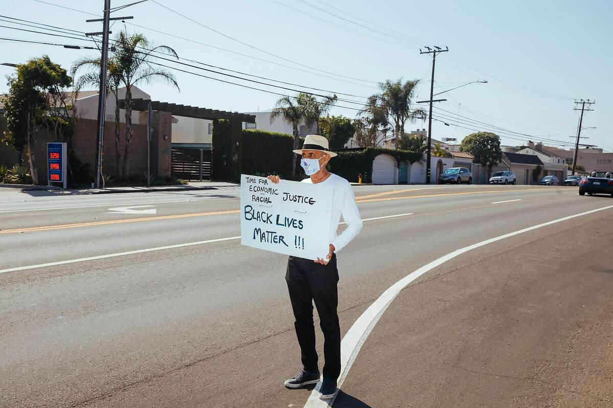 Jack Kornfield, author, Buddhist practitioner and one of the key teachers to introduce Buddhist mindfulness practice to the West, protests for Black Lives Matter alone on the side of the Pacific Coast Highway on Saturday, Oct. 3, 2020 in Malibu, Calif.