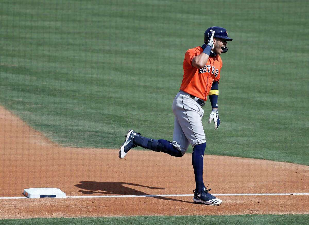 Houston Astros Carlos Correa (1) puts his hand to his ear as he rounded third base after his home run during the fourth inning of Game 1 of the American League Division Series, Monday, October 5, 2020, in Los Angeles, at Dodger Stadium.