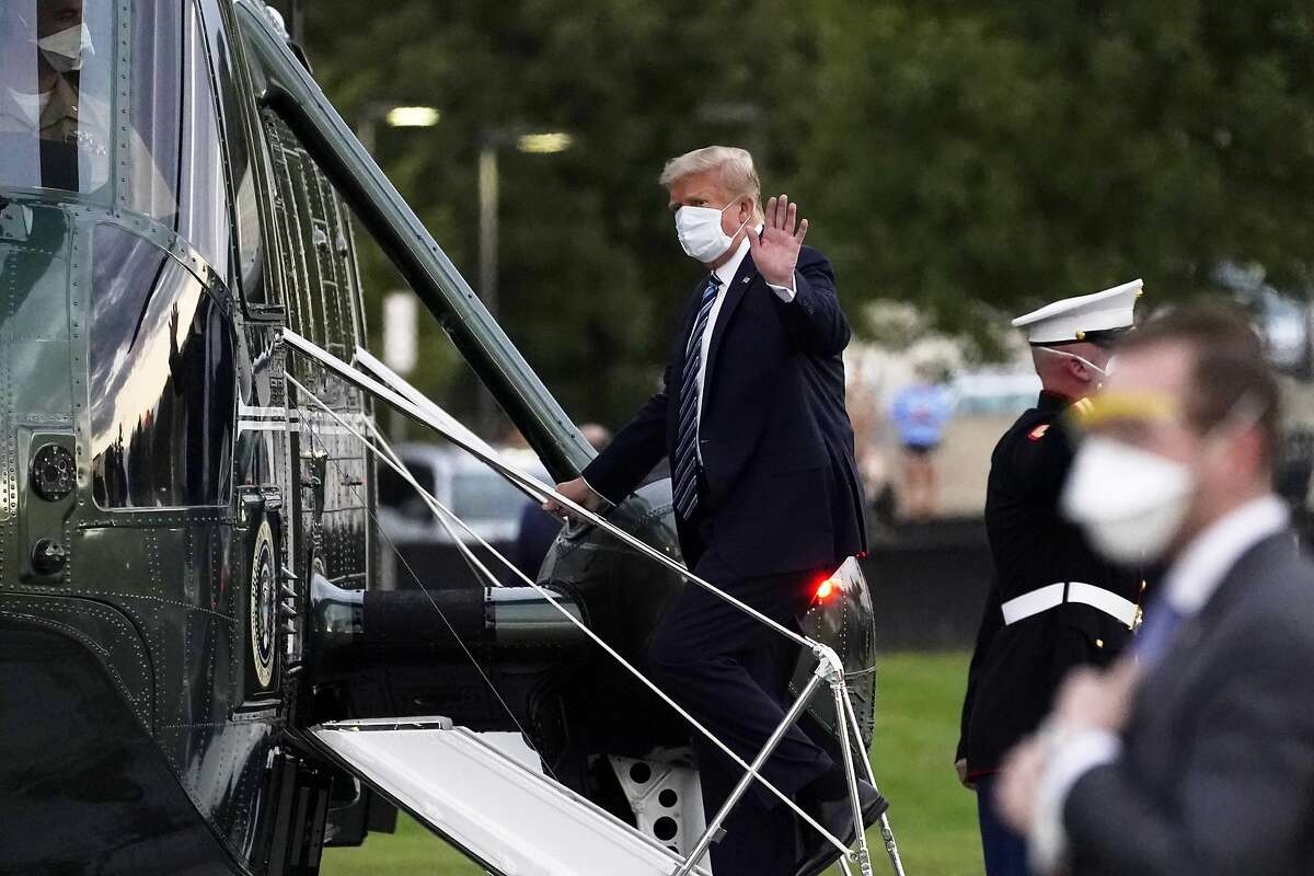 President Donald Trump boards Marine One to return to the White House after receiving treatments for covid-19 at Walter Reed National Military Medical Center, Monday, Oct. 5, 2020, in Bethesda, Md. (AP Photo/Evan Vucci)