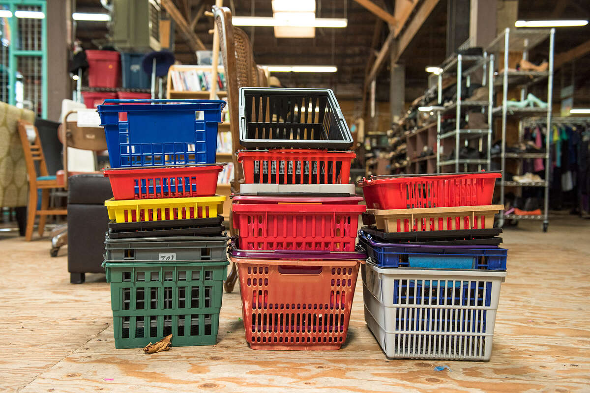 Freshly sanitized shopping baskets are stacked up and ready to use when customers walk through the steel garage door entryway of Community Thrift.