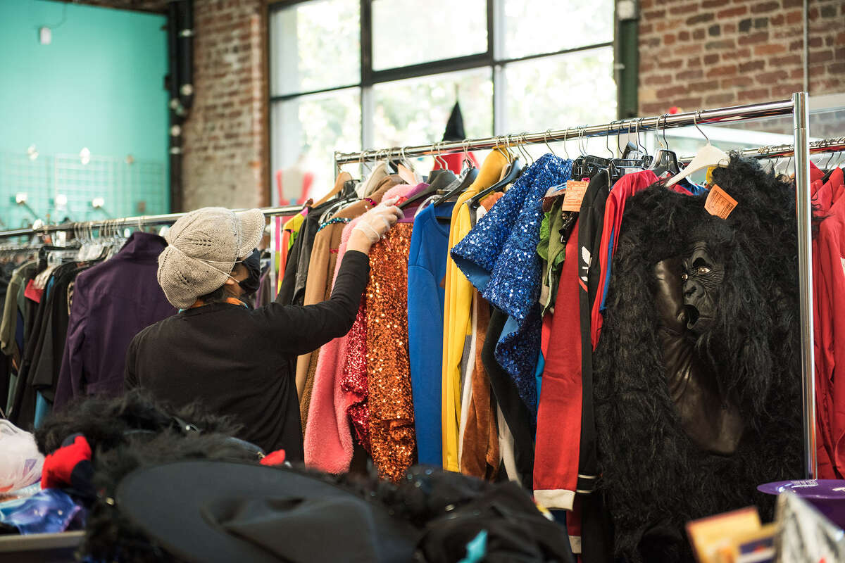 A customer sifts through a clothing rack at Community Thrift, one of the oldest independent thrift shops in San Francisco.