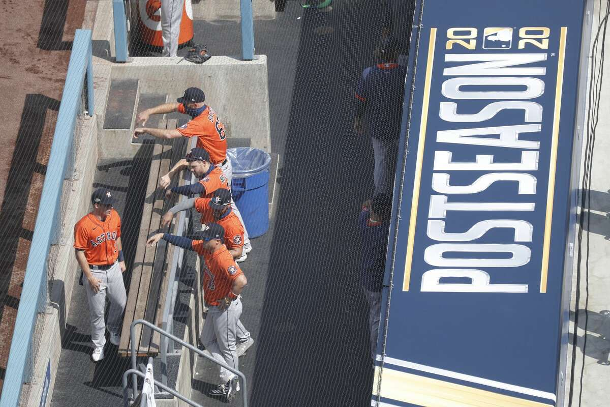 Houston Astros in the dugout before the start of the first inning of Game 1 of the American League Division Series, Monday, October 5, 2020, in Los Angeles, at Dodger Stadium.