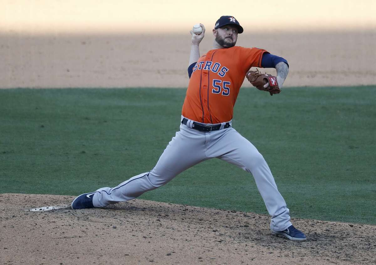 Houston Astros relief pitcher Ryan Pressly (55) pitches during the ninth inning of Game 1 of the American League Division Series, Monday, October 5, 2020, in Los Angeles, at Dodger Stadium.