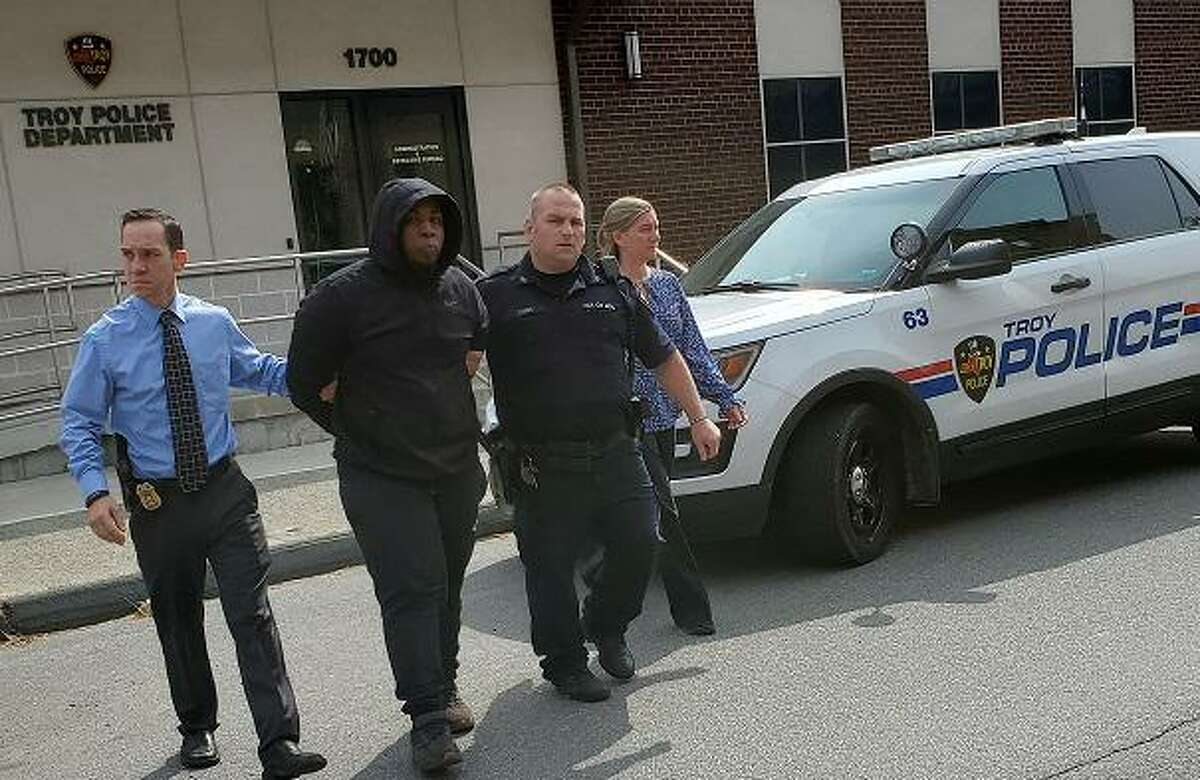 Troy police detective and patrol officer lead Jahquay E. Brown from the detective bureau to arraignment in Troy City Court Thursday, Sept. 24, 2020.Troy police detective and patrol officer lead Jahquay E. Brown from the detective bureau to arraignment in Troy City Court Thursday, Sept. 24, 2020. (Troy Police Department)