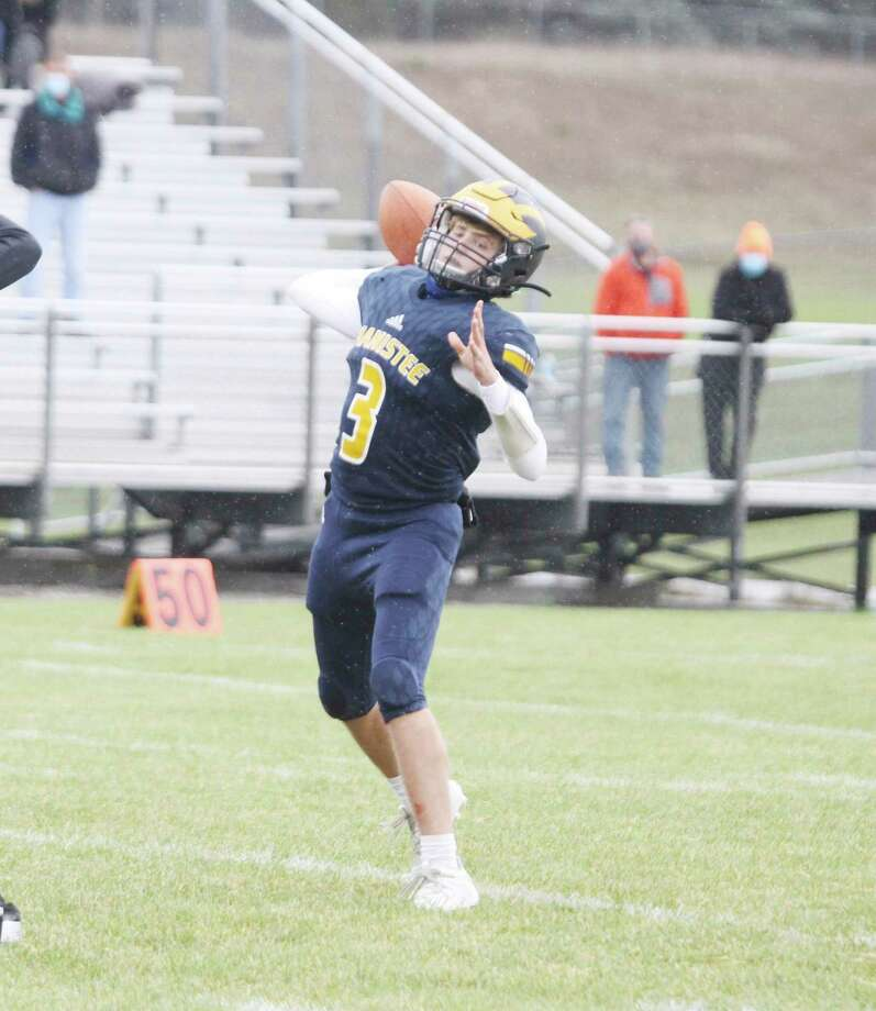 Manistee quarterback Jeff Huber throws a pass at Chippewa Field on Saturday. Spectator limits will be increased across the state beginning Friday. (Dylan Savela/News Advocate)