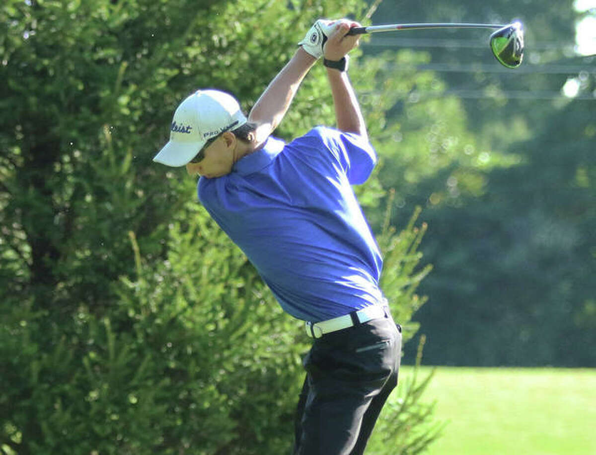 Marquette Catholic's William Roderfeld hits a drive during the Madison County Tourney on Aug. 17 at Belk Park in Wood River. Rodefeld, a senior, and the Explorers play Tuesday in the Mount Olive Class 1A Regional at Timber Lakes in Staunton.