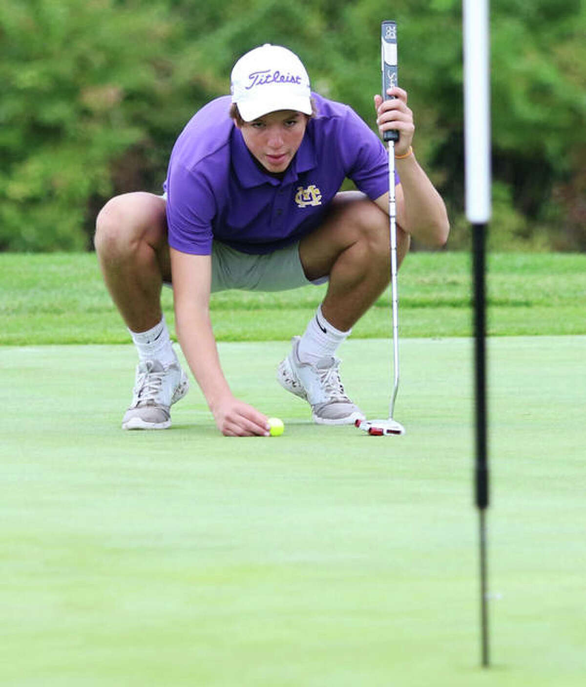 CM's Manny Silva places his putt on the 18th green during the MVC Tournament on Sept. 23 at Belk Park in Wood River. Silva and the Eagles are back at Belk on Tuesday at the Roxana Class 2A Regional.