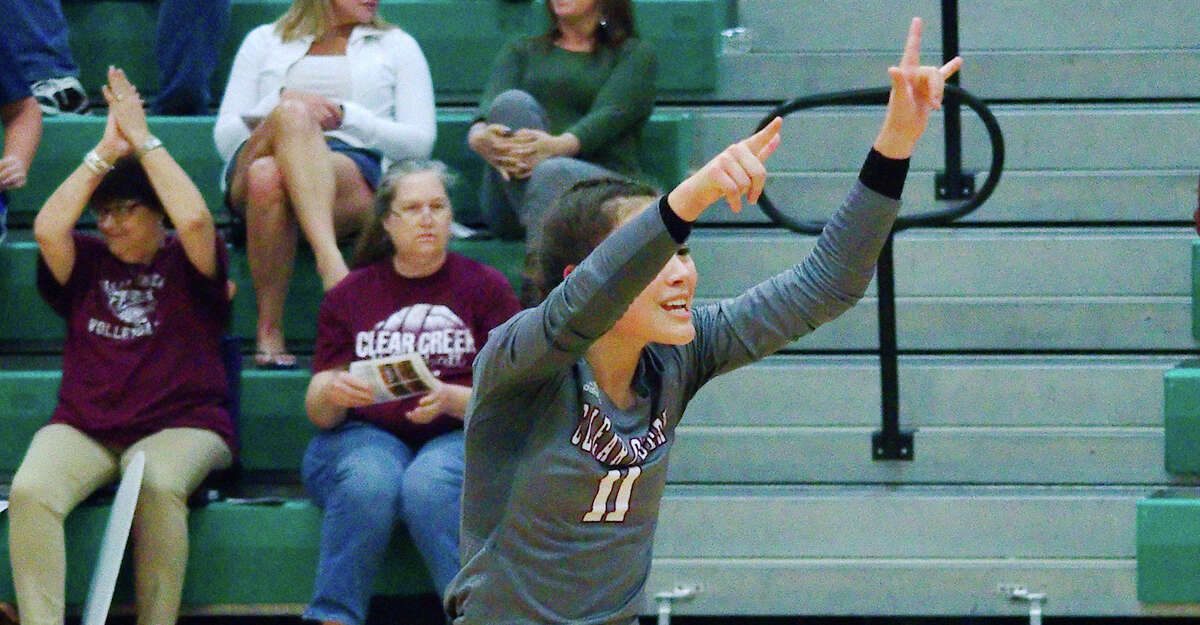Clear Creek's Briana Zamora (11) celebrates a point against Clear Falls on Oct. 1, 2019 at Clear Falls High School.