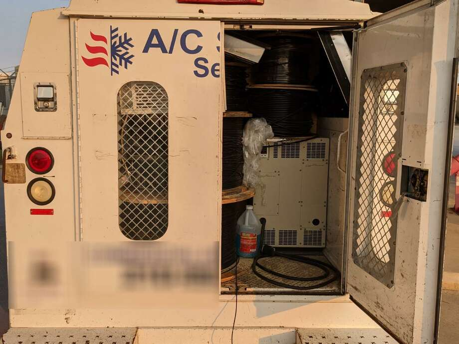 U.S. Border Patrol agents discovered 18 immigrants behind a false wall in this utility van. All were citizens of Mexico and Honduras who had crossed the border illegally. Photo: Courtesy Photo /U.S. Border Patrol