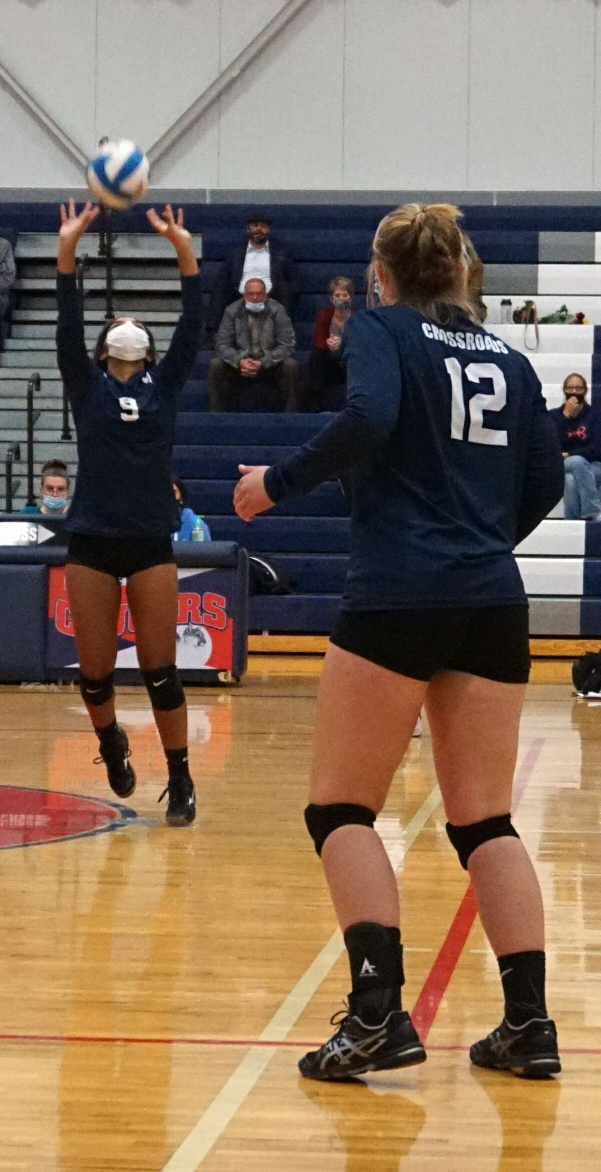 The Cougars of Crossroads Charter Academy were taken down by Algoma Christian School in four sets on Monday night.
