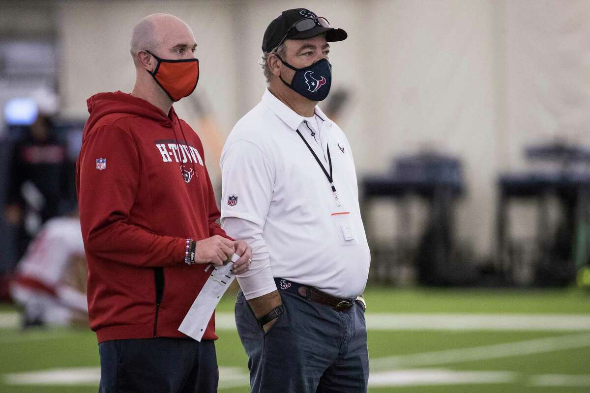 Texans owner Cal McNair (right) watches practice with his executive vice president of football operations Jack Easterby.