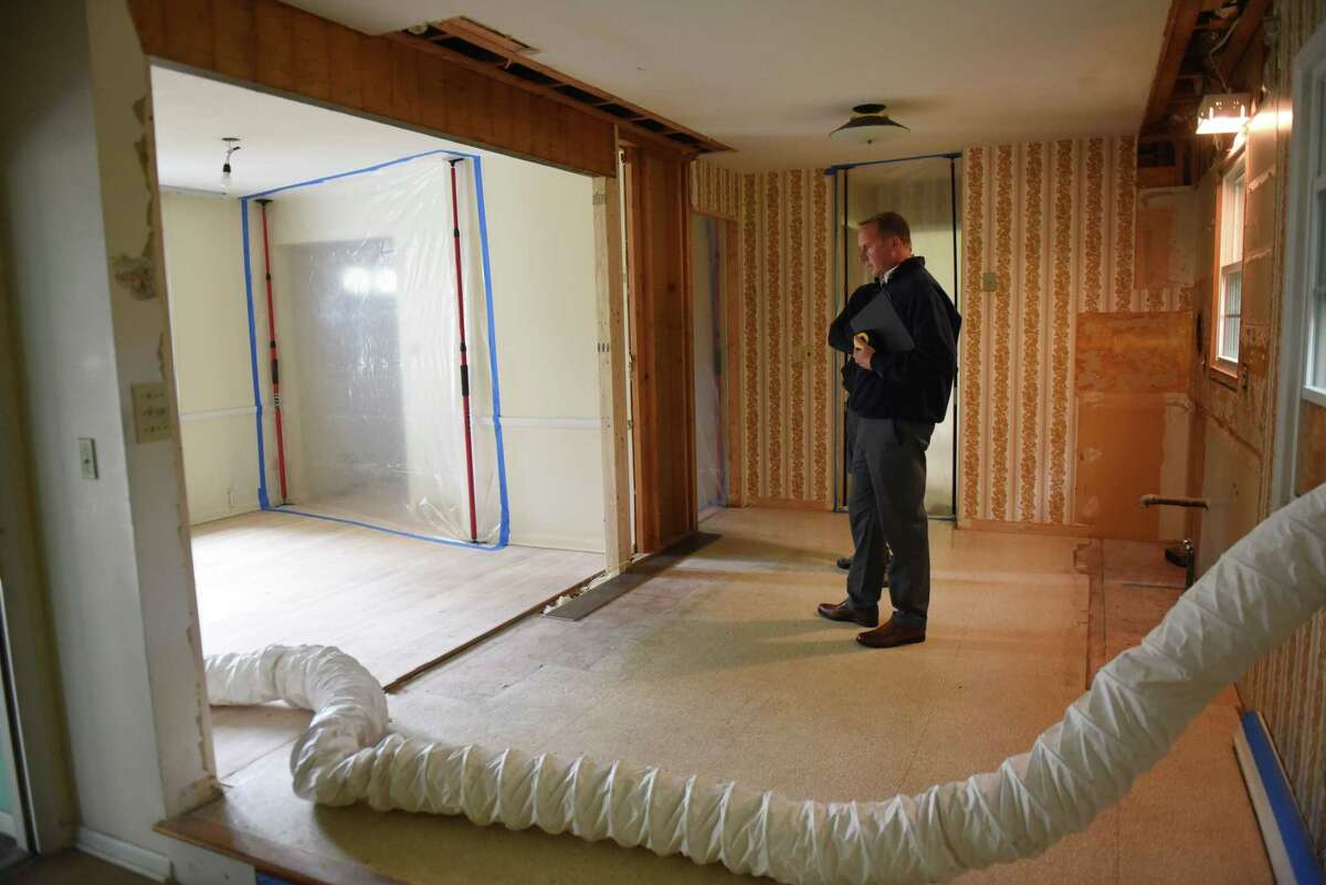 Gregg Biché, the owner of Quality PM Property Management and Contracting for Renew, inspects work inside a Delmar home which his company is renovating on Friday Oct. 2, 2020, in Delmar, N.Y. (Will Waldron/Times Union)