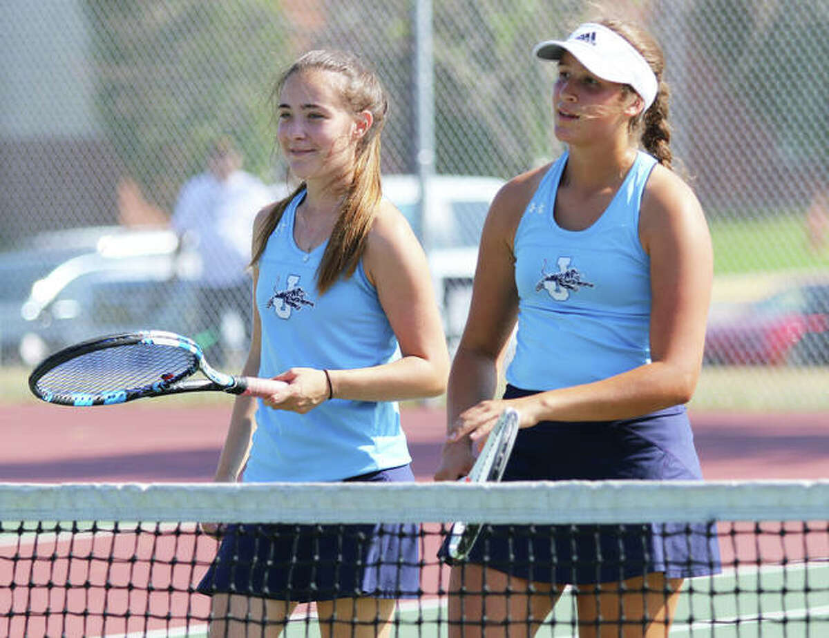 Jersey's Lily Ingram (left) and Michelle Maag downed Highland's Hannah Geest and Krista Rittenhouse 6-3, 6-1 to win at No. 1 doubles in Monday's 5-4 victory over Highland at JCHS. They are shown earlier this season at the Southern Illinois Duals tournament.