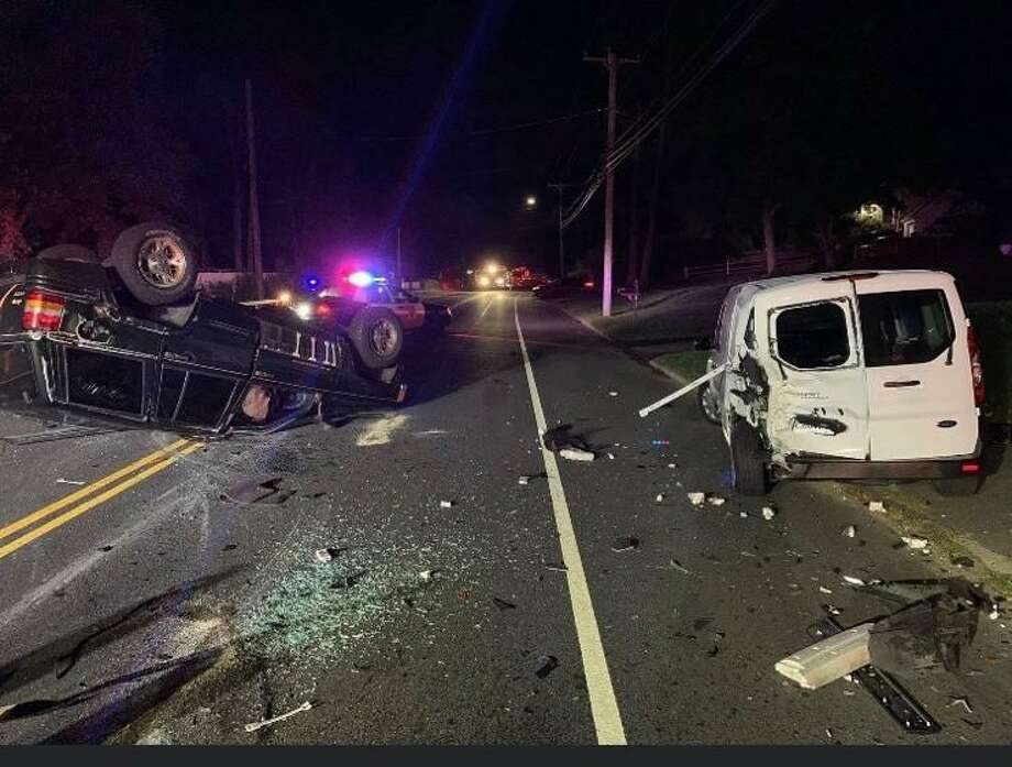 Shelton firefighters responded to a two-vehicle crash on River Road Monday, Oct. 5, at 7:30 p.m. One person was hospitalized. Photo: Shelton Fire Department / Contributed Photo / Connecticut Post