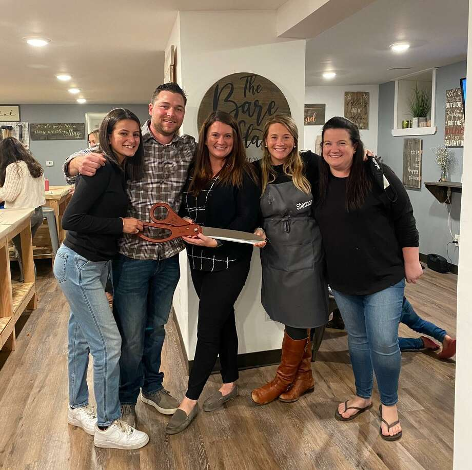 Molly Shea and Robert Davies held the grand opening Thursday, Oct. 1, for their new business, The Bare Slate. Pictured are staffers, left to right, Gabriella Perry, Davies, Shea, Shannon Ottowell and Meghan Pane. Photo: Charles Duck Unitas / Contributed Photo / Connecticut Post