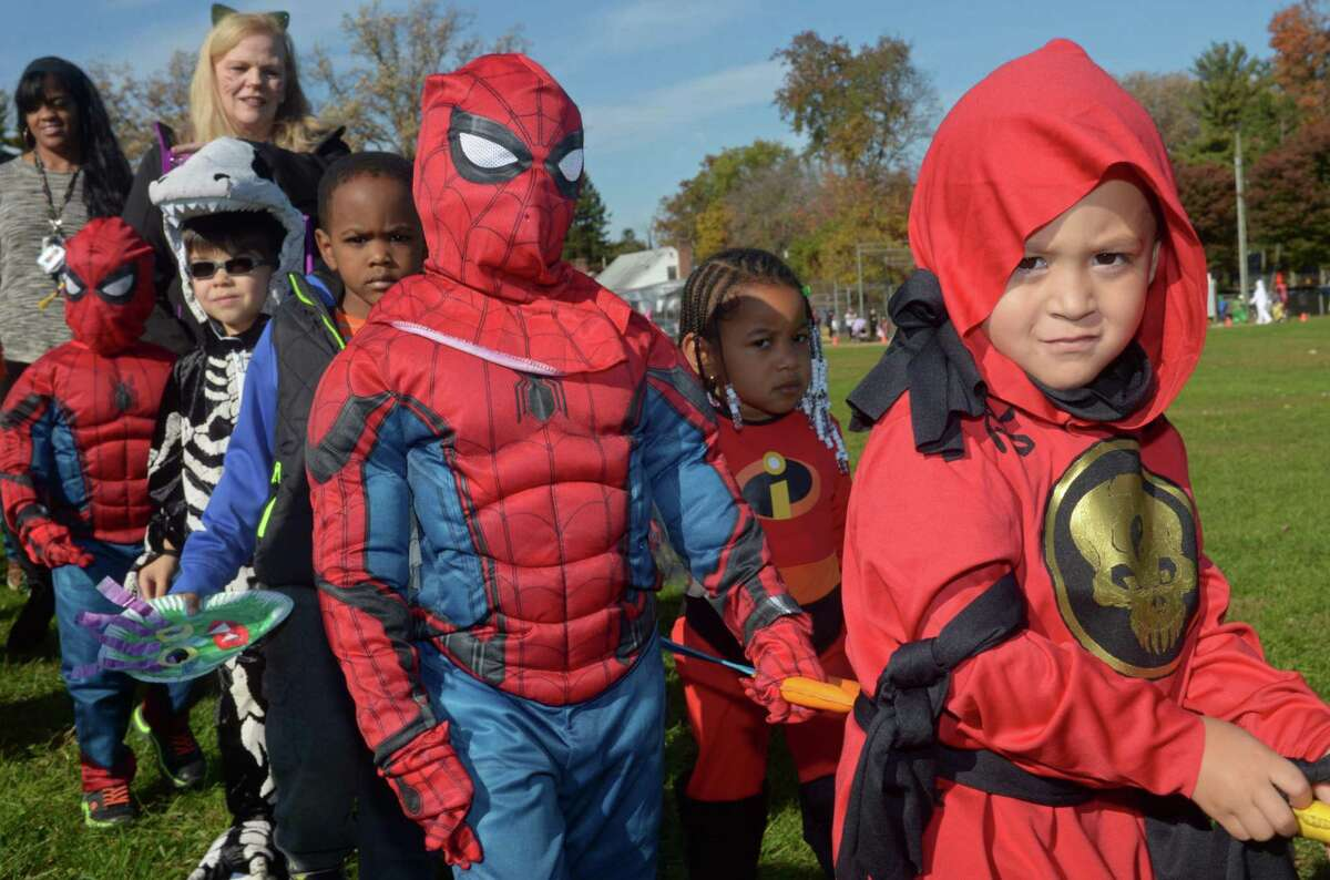 Preschoolers Christopher Preston and Caleb Pote march with their class during the Brookside Elementary School annual schoolwide Halloween Parade Wednesday, October 31, 2018, at the school in Norwalk, Conn. Halloween may look different this year under new social distancing guidelines.