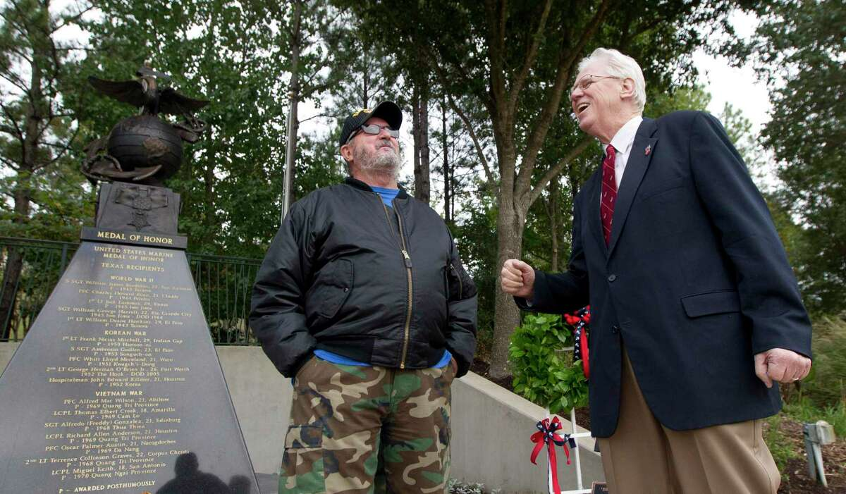 The annual celebration of the U.S. Marine Corps birthday will occur Nov. 6 at Town Green Park in The Woodlands with an in-person event but several changes due to the COVID-19 pandemic. In this 2019 file photograph, U.S. Marine Corps veteran David Ross, right, tells a story about his time in the service beside fellow Marine, Dale Blanton, as veterans gathered Friday in The Woodlands at the Texas Marine Medal of Honor Monument to celebrate the 244th birthday of the Marine Corps.