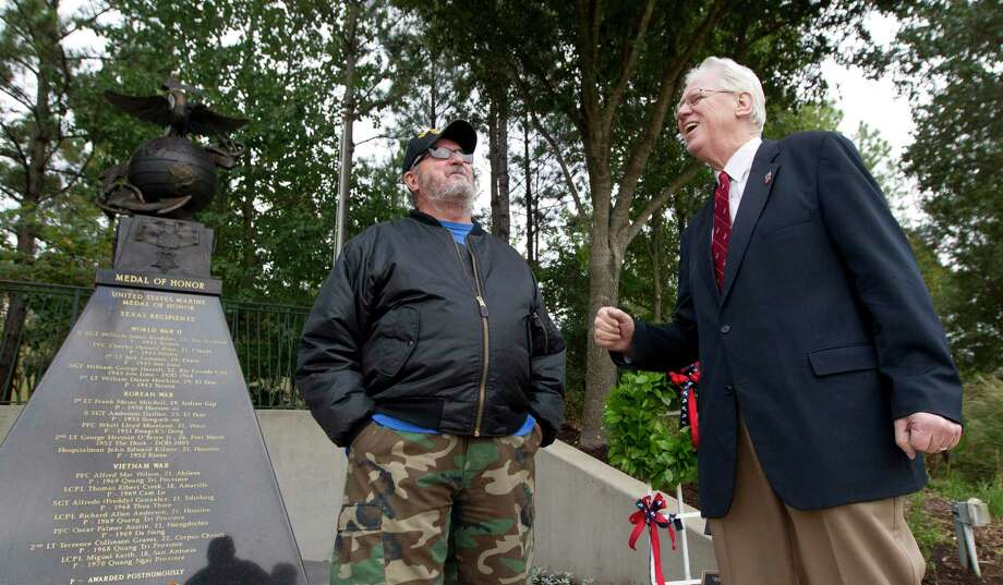 The annual celebration of the U.S. Marine Corps birthday will occur Nov. 6 at Town Green Park in The Woodlands with an in-person event but several changes due to the COVID-19 pandemic. In this 2019 file photograph, U.S. Marine Corps veteran David Ross, right, tells a story about his time in the service beside fellow Marine, Dale Blanton, as veterans gathered Friday in The Woodlands at the Texas Marine Medal of Honor Monument to celebrate the 244th birthday of the Marine Corps. Photo: Jason Fochtman, Houston Chronicle / Staff Photographer / Houston Chronicle