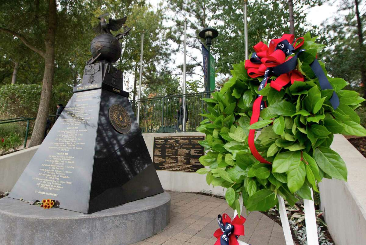 A wreath is seen beside the Texas Marine Medal of Honor Monument in honor of the 244th birthday of the Marine Corps at Town Green Park, Friday, Nov. 8, 2019, in The Woodlands.